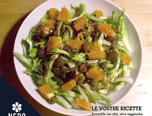 Puntarelle, alici, olive taggiasche, arance e aglio nero